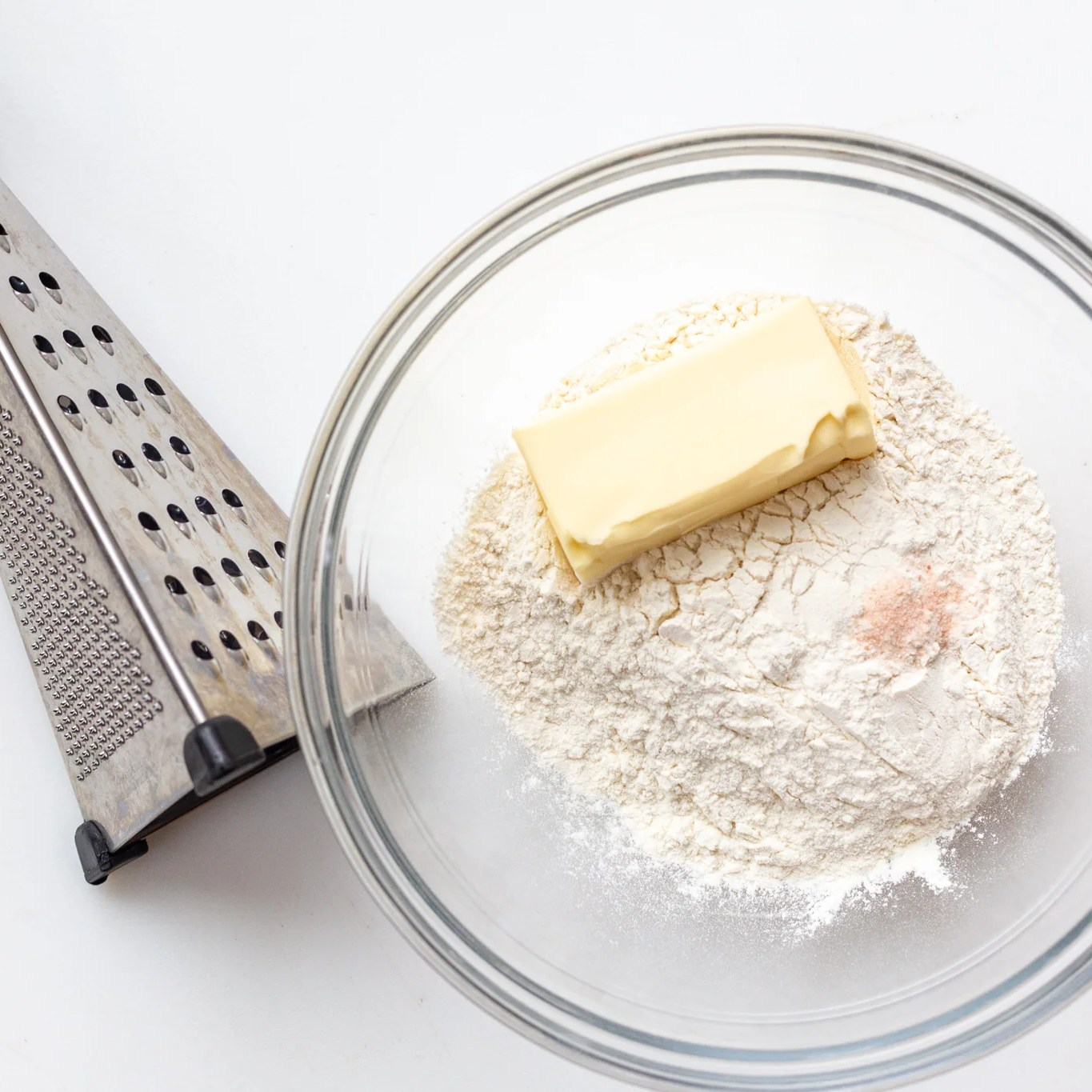 flour in a bowl with butter
