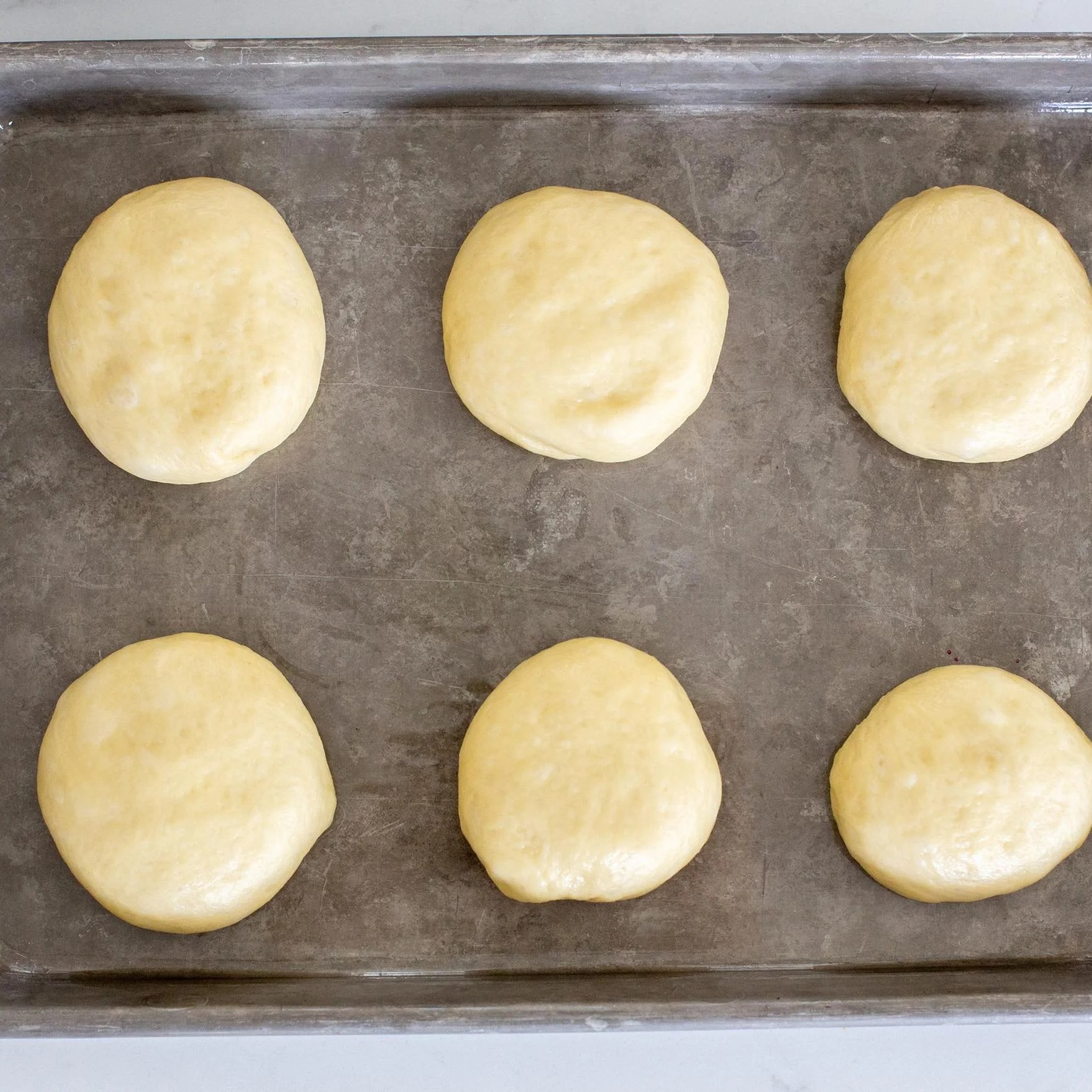 Brioche Buns on a baking sheet