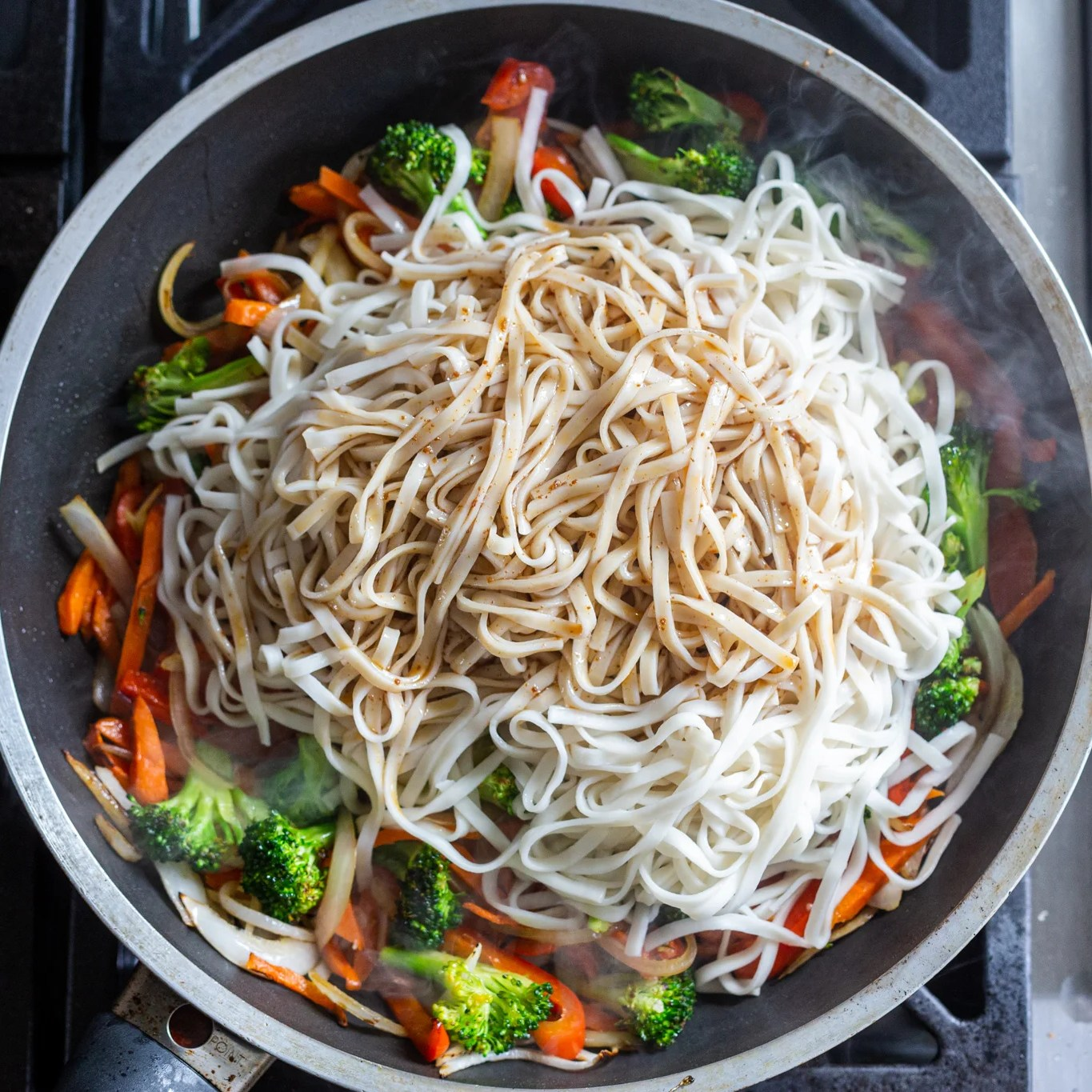Noodles and sauce added to a skillet