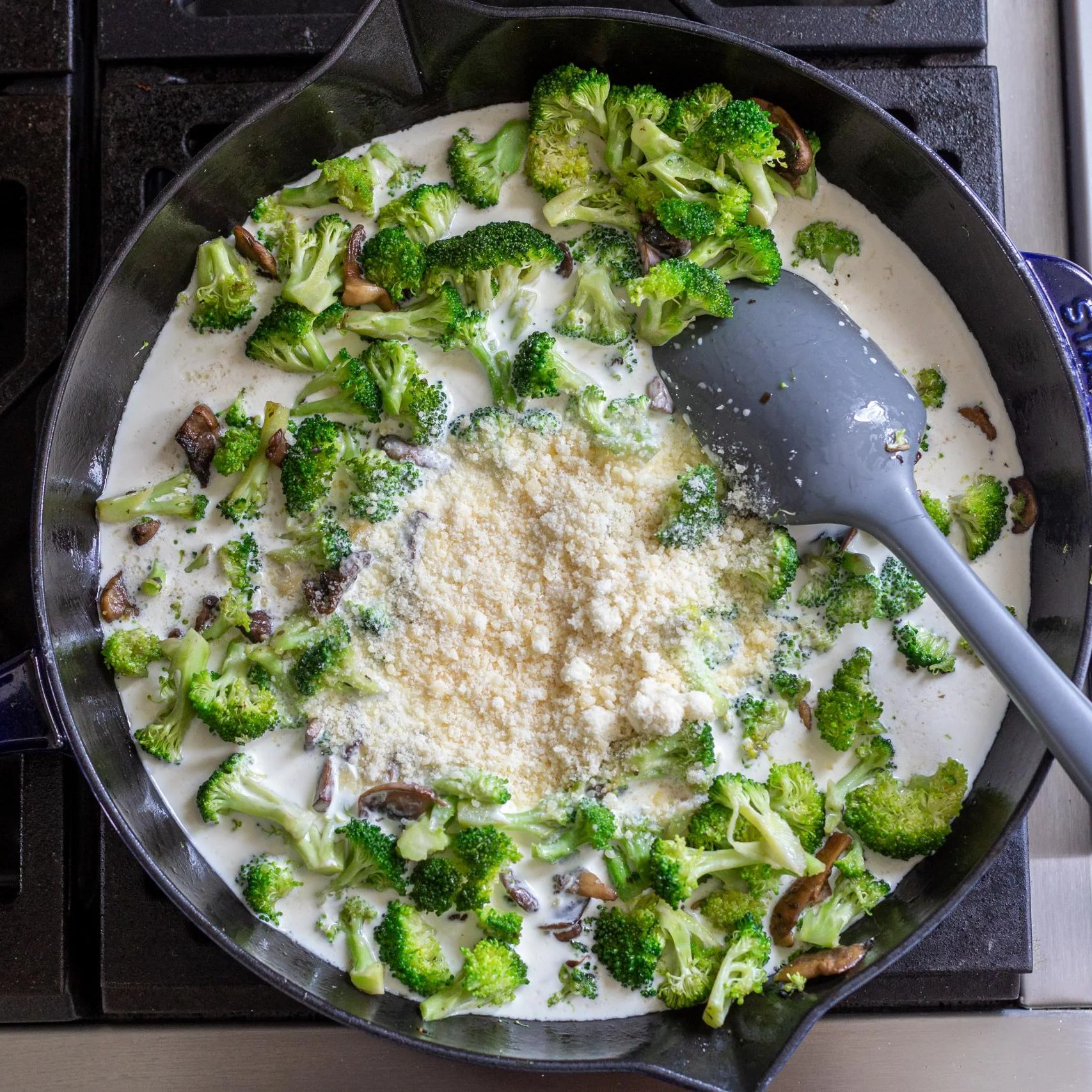 broccoli, cream and parmesan in a pan