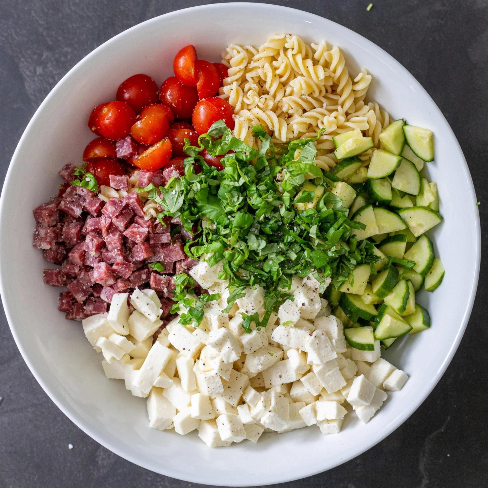 A bowl Italian pasta salad ingredients