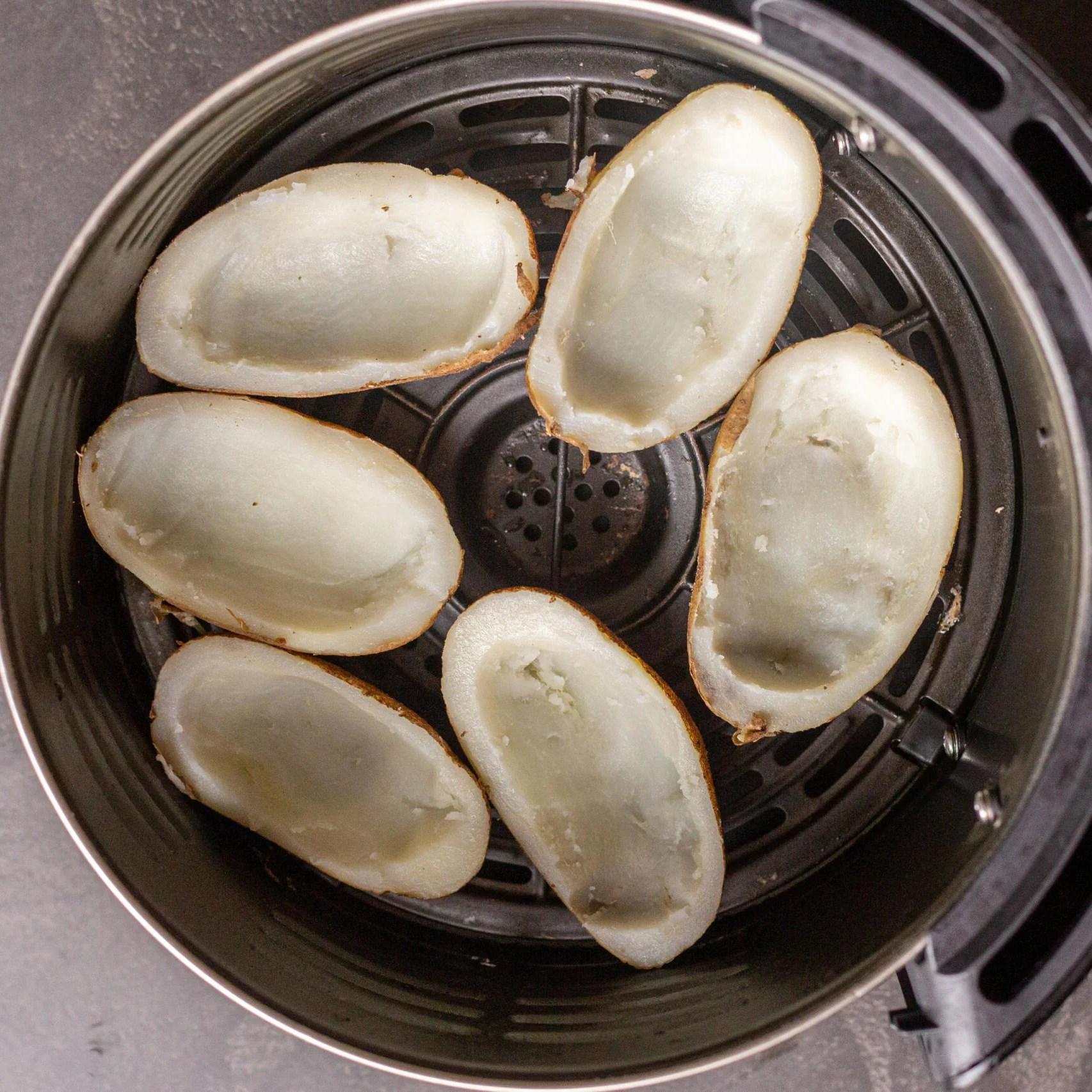 Potato skins in an air fryer basket