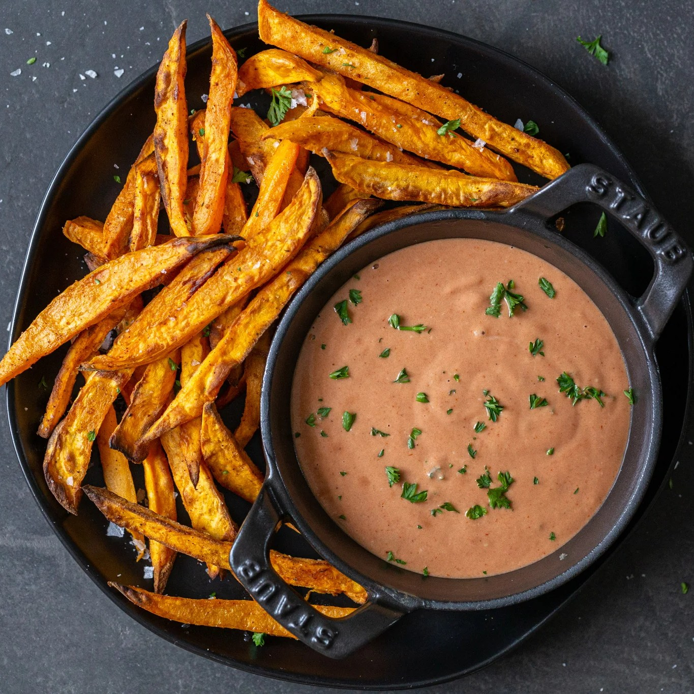 Sweet potato fries on a plate with sauce