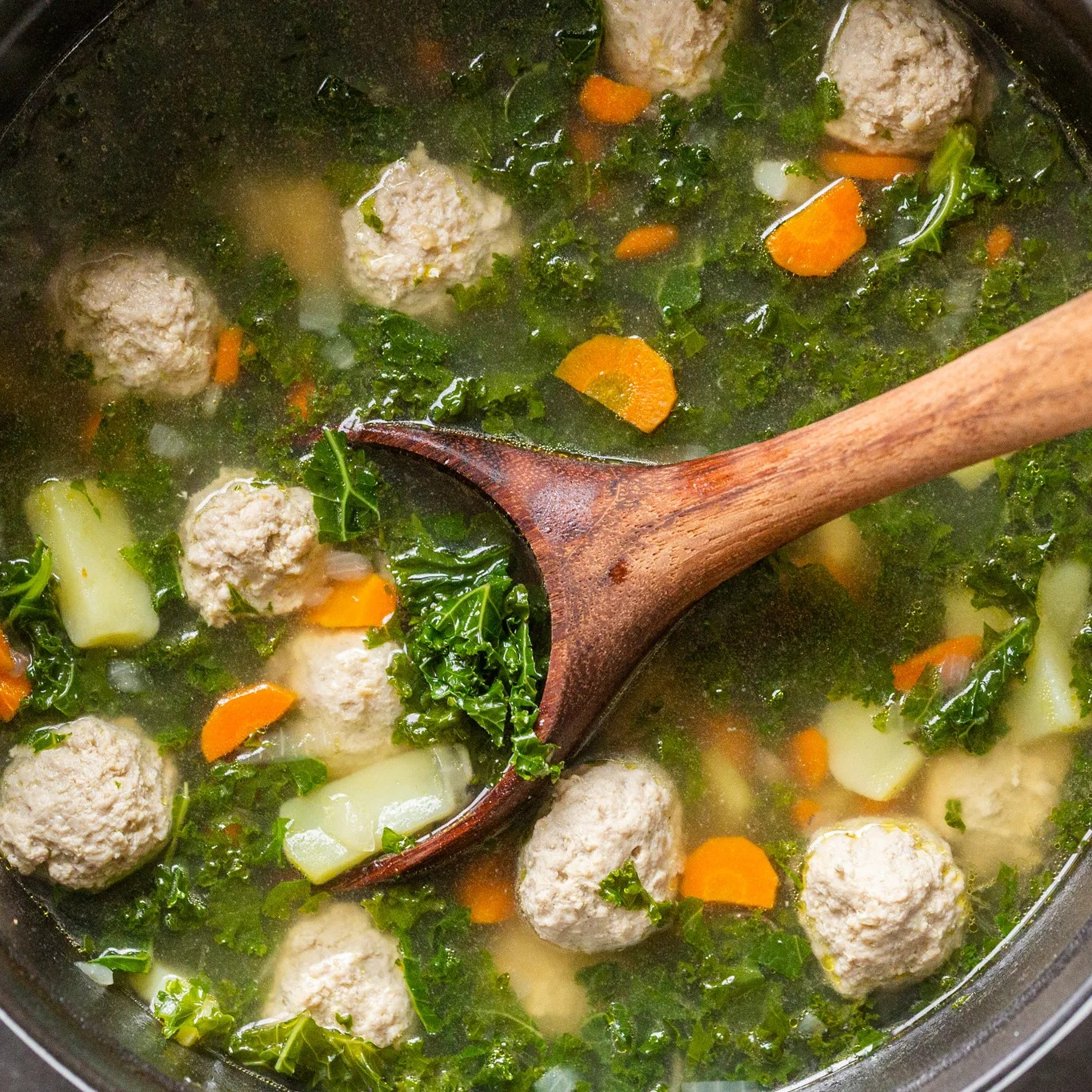 A pot of kale meatball soup