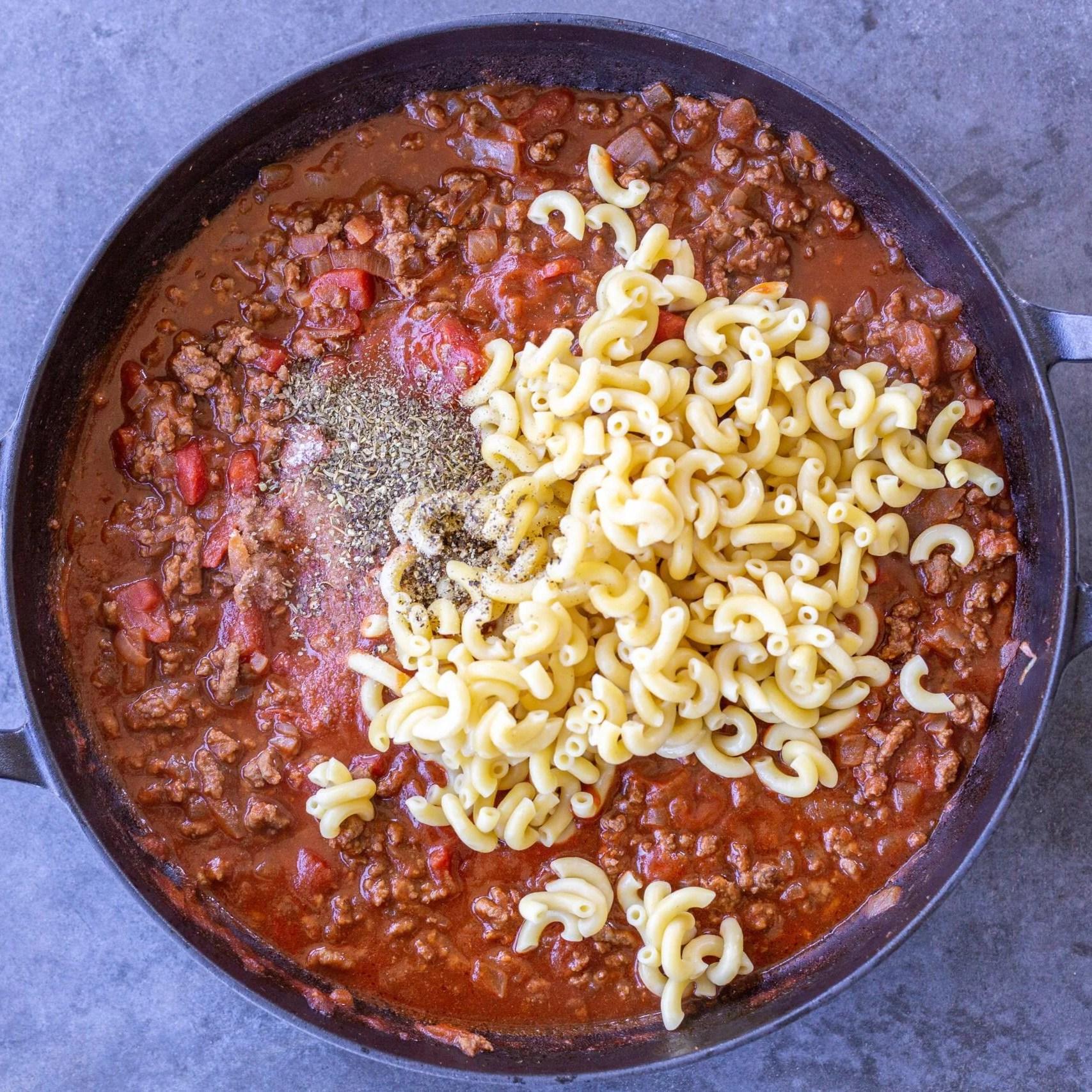 Macaroni added to a pan