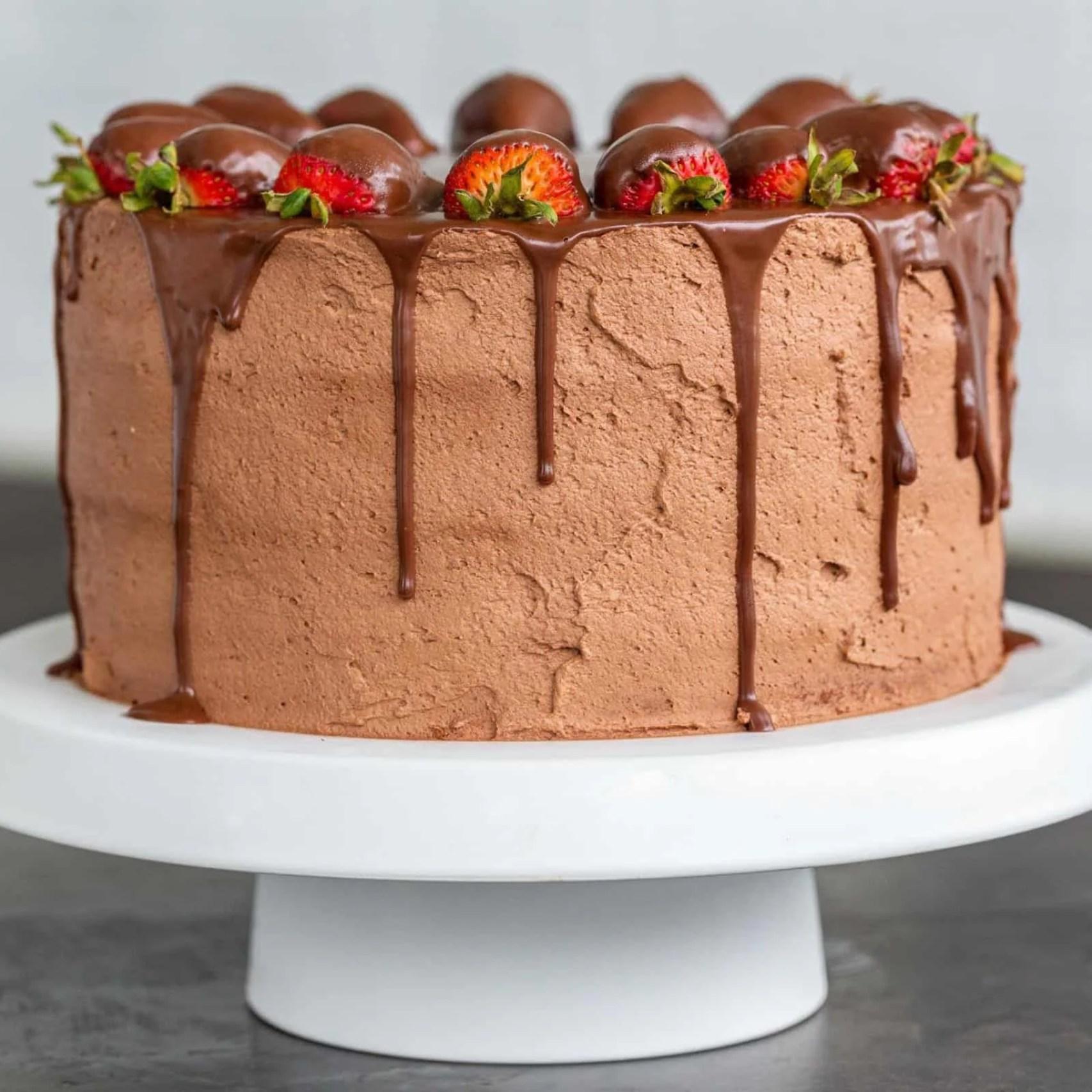 Strawberry chocolate cake on a cake stand