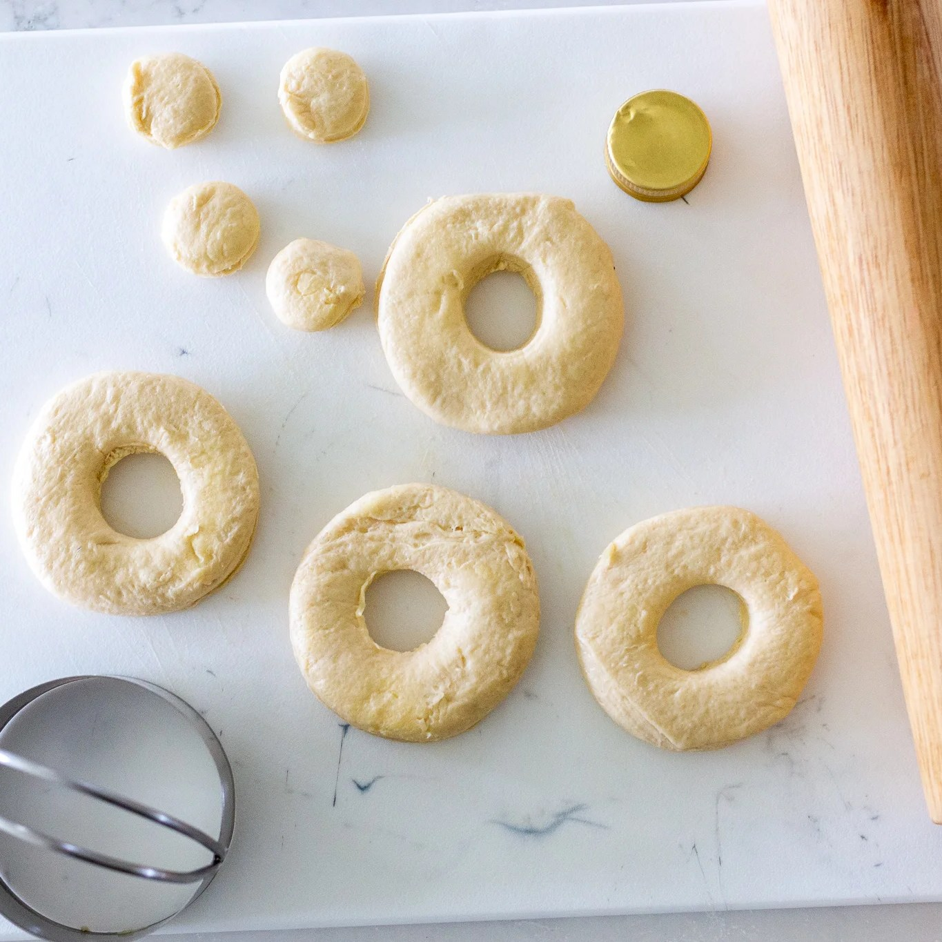Cut out donut holes on a cutting board