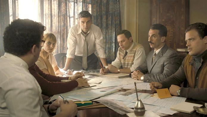 The characters of Operation Finale, one of the best Netflix war movies, at a table