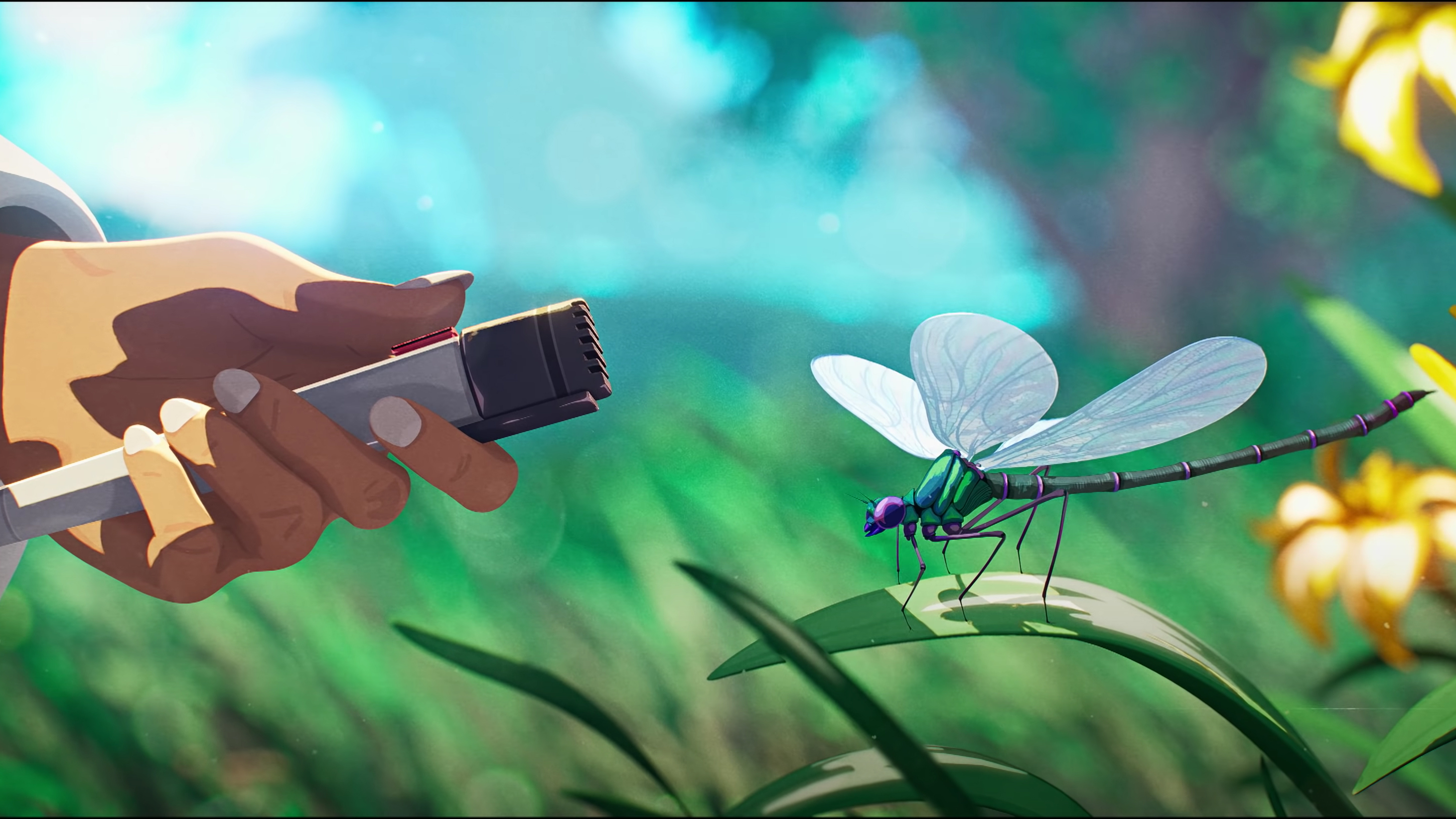 A microphone being held next to a dragonfly
