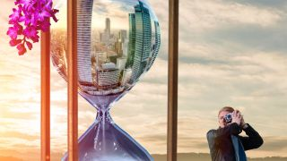 an hourglass with a skyscraper scene in it