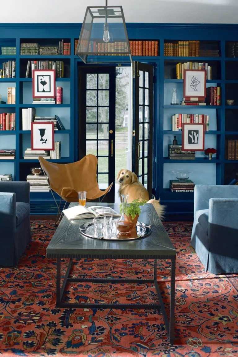 Blue living room with built in bookcase painted in Benjamin Moore Lucern