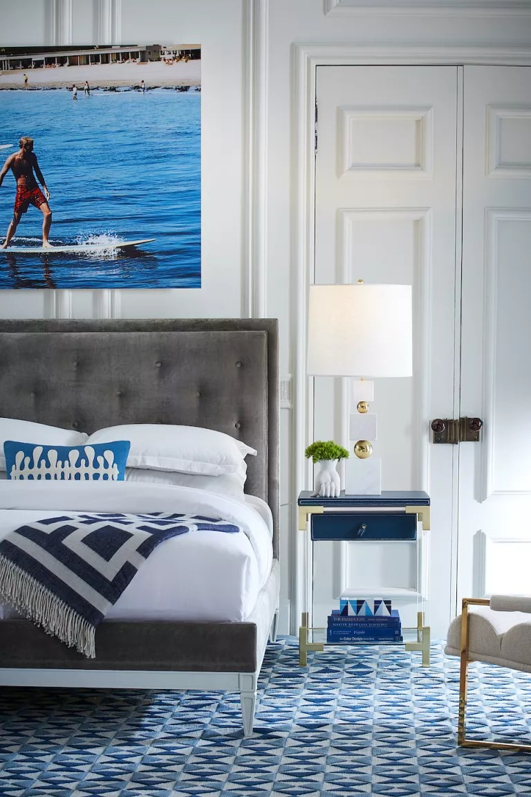 bedroom ideas for men, blue and white bedroom with art by Jonathan Adler