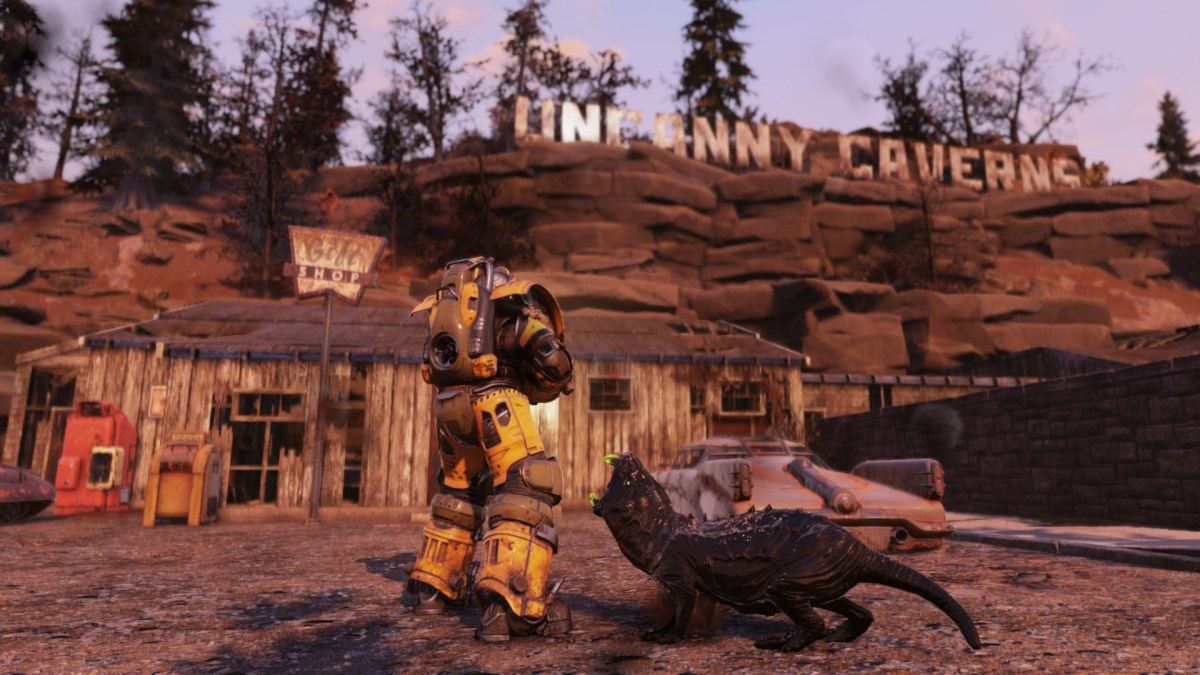 Fallout 76 Steel Reign review — a shot of a player in front of the Uncanny Caverns being attacked by a glowing mole rat