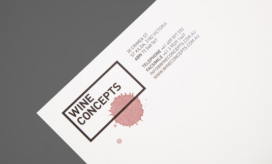 The subtle Wine Concepts logo and contact details are printed in black at the top of a page, with a splash of red wine over part of the logo