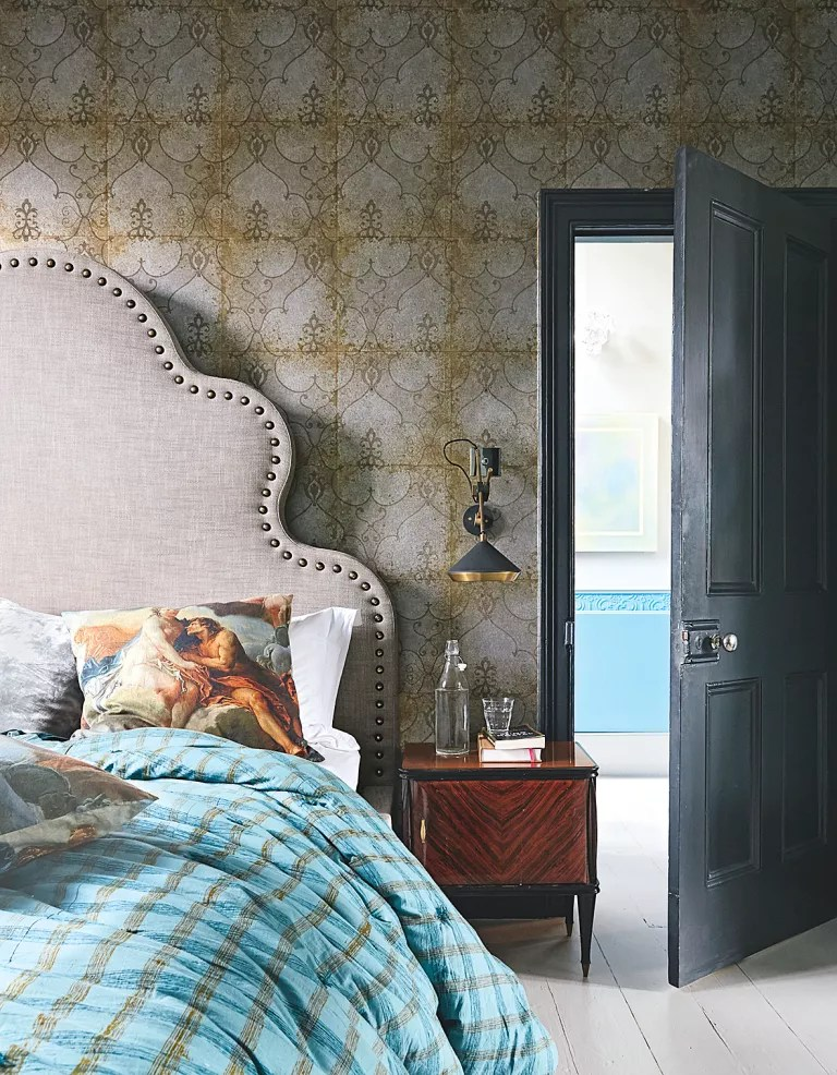 Bedroom with vintage style wallpaper and headboard