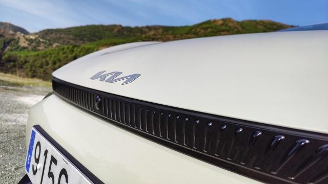 Close up of Kia badge on hood of EV6
