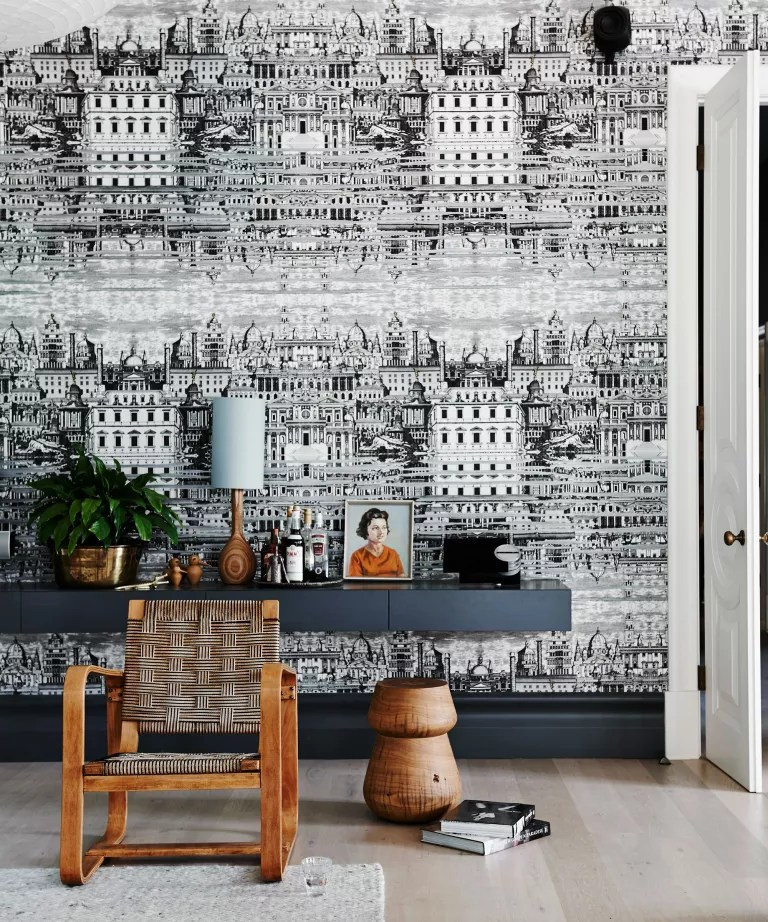 Black living room with monochrome wallpaper