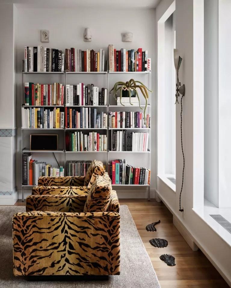 Living room with bookshelf and animal print chairs