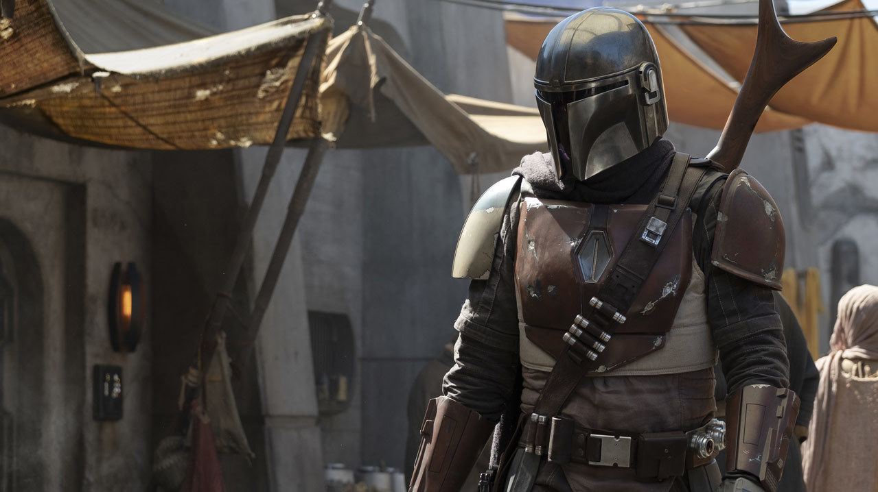 The first image from the Star Wars live action show The Mandalorian, showing a person wearing Mandalorian armor