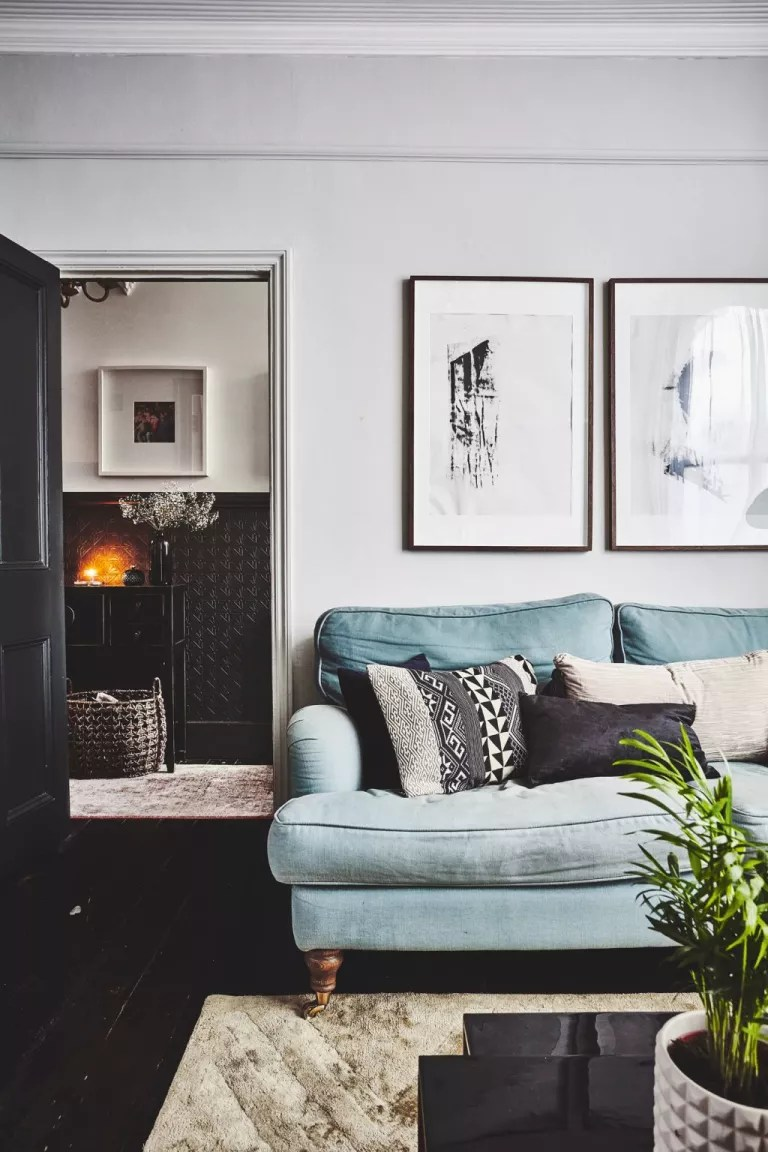 Small living room idea with white white and dark floorboards
