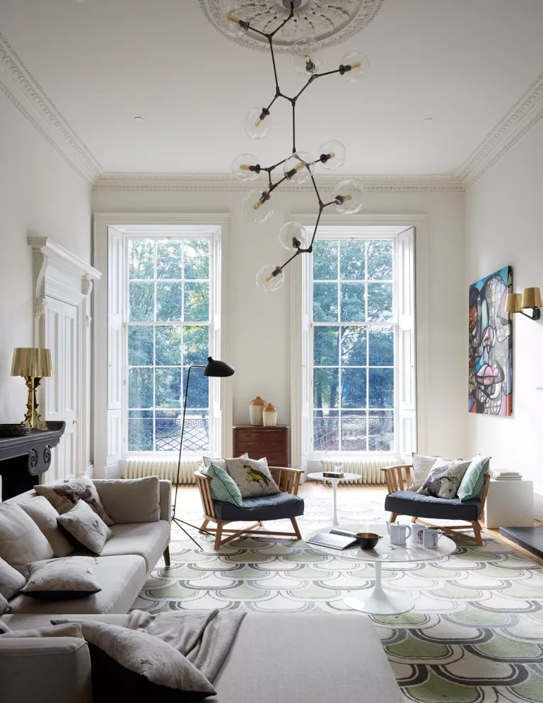 Elegant living room with high ceiling and large windows