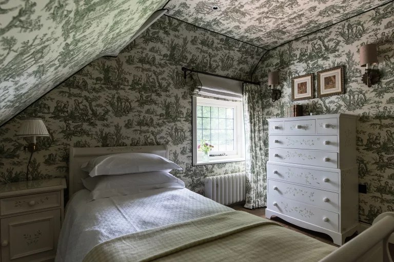 Cottage bedroom ideas - toile ceiling and walls in cottage bedroom style by Louise Jones Interiors
