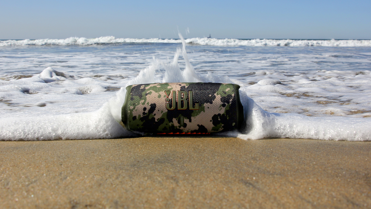 the JBL Charge 5 bluetooth speaker on a beach
