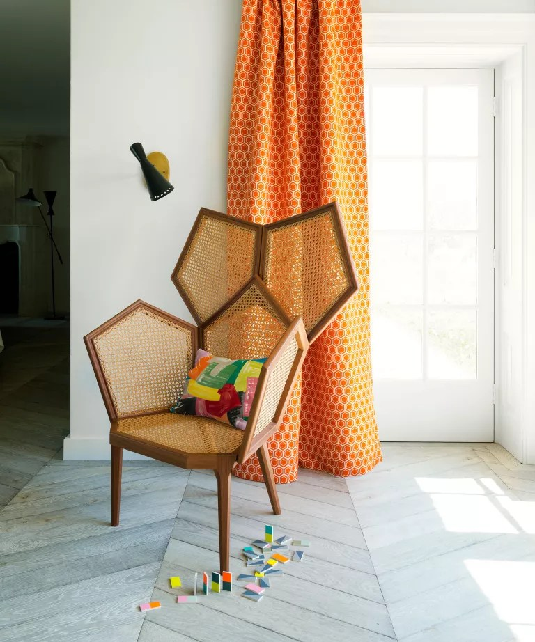 Mid-century modern living room with rattan chair