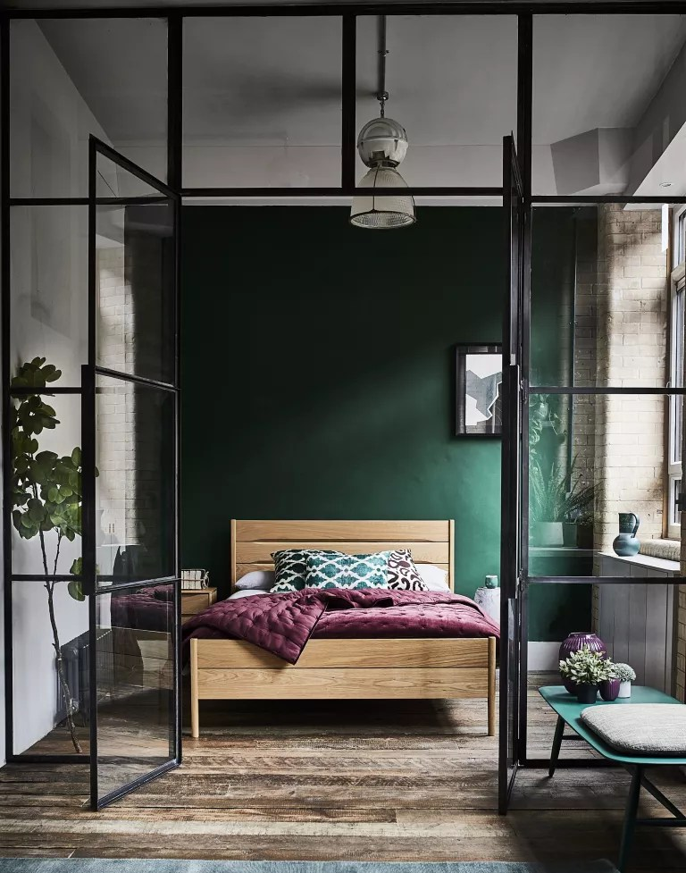 green bedroom with crittall doors by ercol