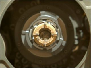 A Martian rock core sample, about the width of a pencil, sits inside the Perseverance rover's collection tube.