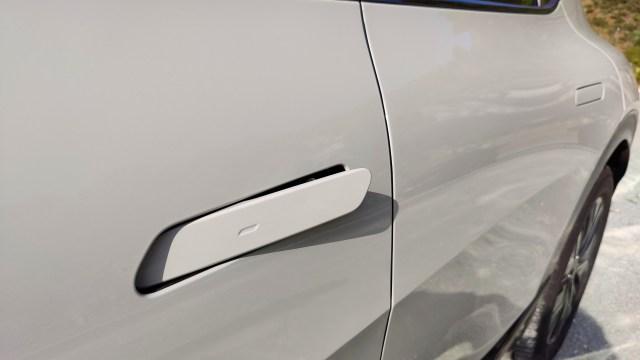 Close up of the protruding door handle on Kia EV6