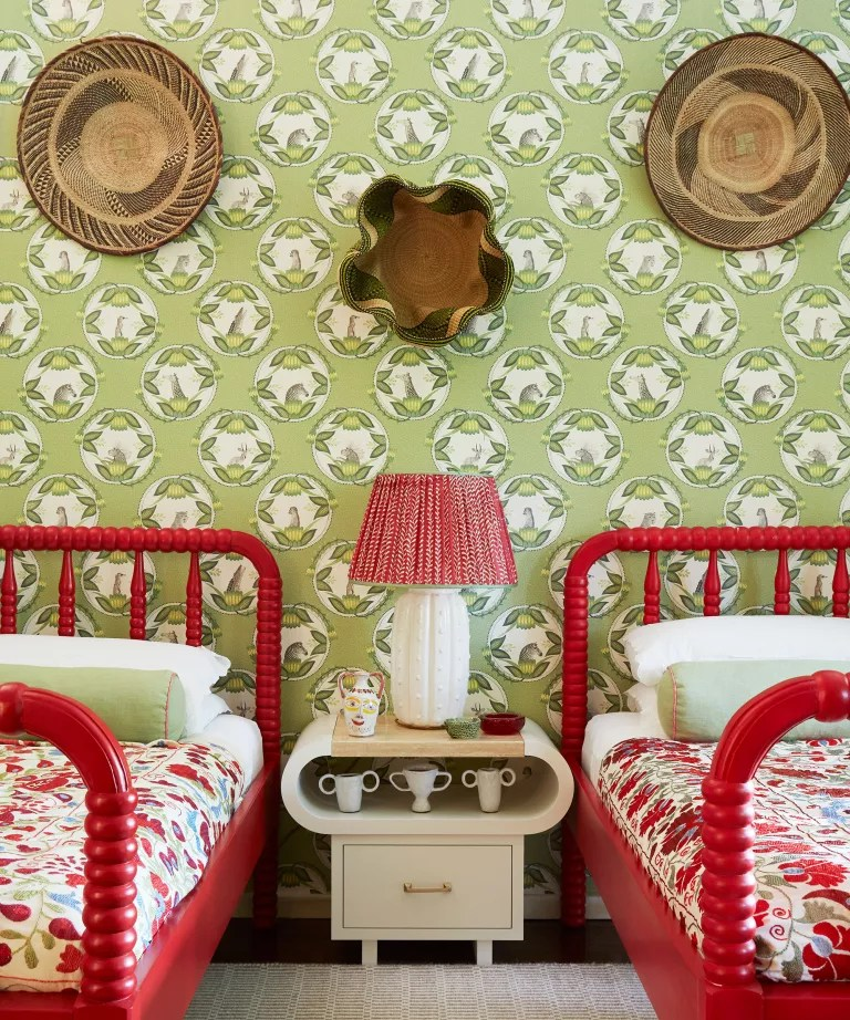 Luxury shared bedroom ideas with green patterned wallpaper and red painted twin beds.