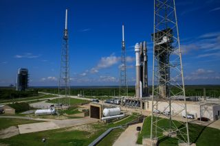 Boeing's Starliner capsule atop its Atlas V rocket as seen on the launch pad on July 29, 2021, before a launch delay and weather concerns prompted mission personnel to roll it back inside for protection.
