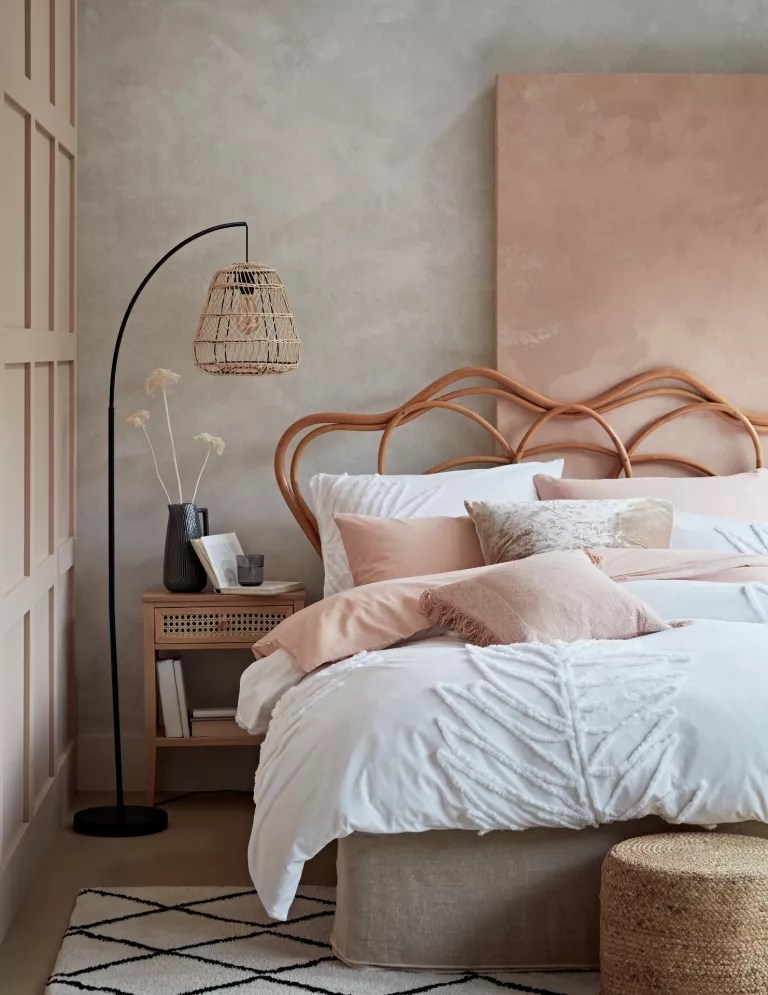 pink bedroom with white bedding