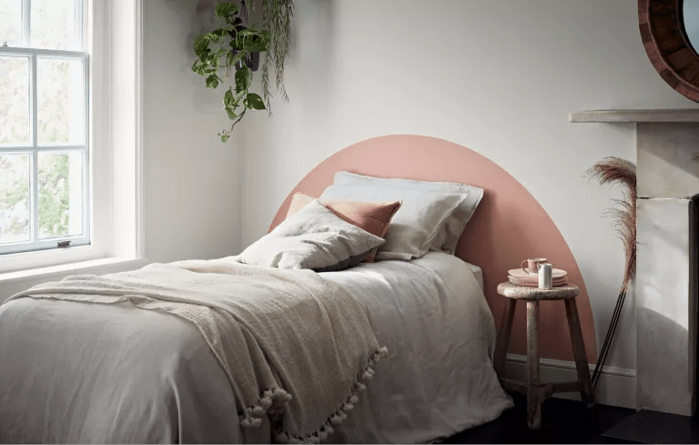 bedroom with painted headboard
