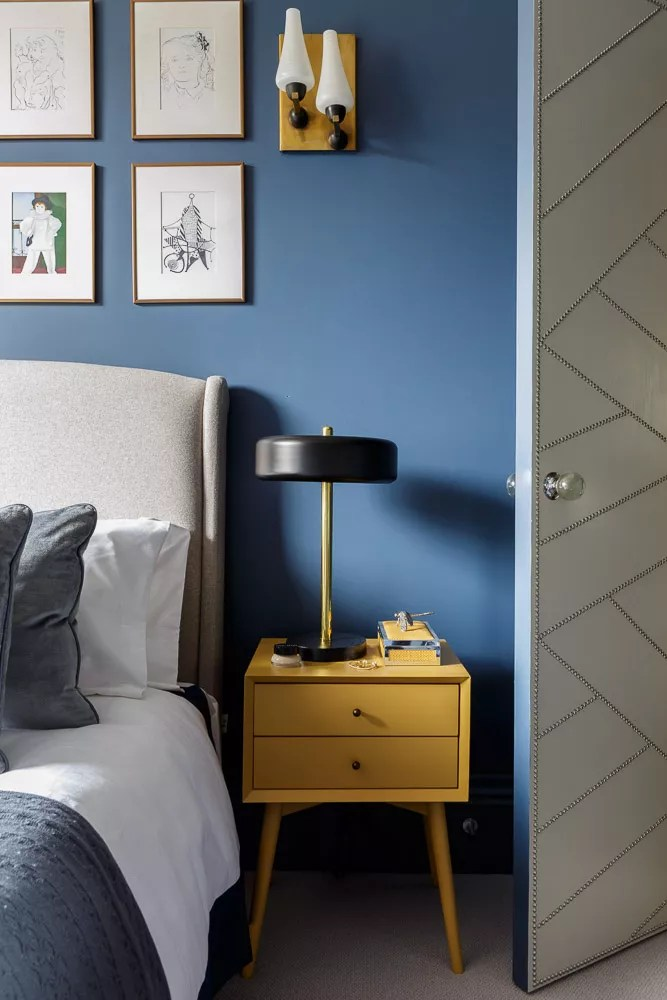 blue bedroom with yellow bedside table