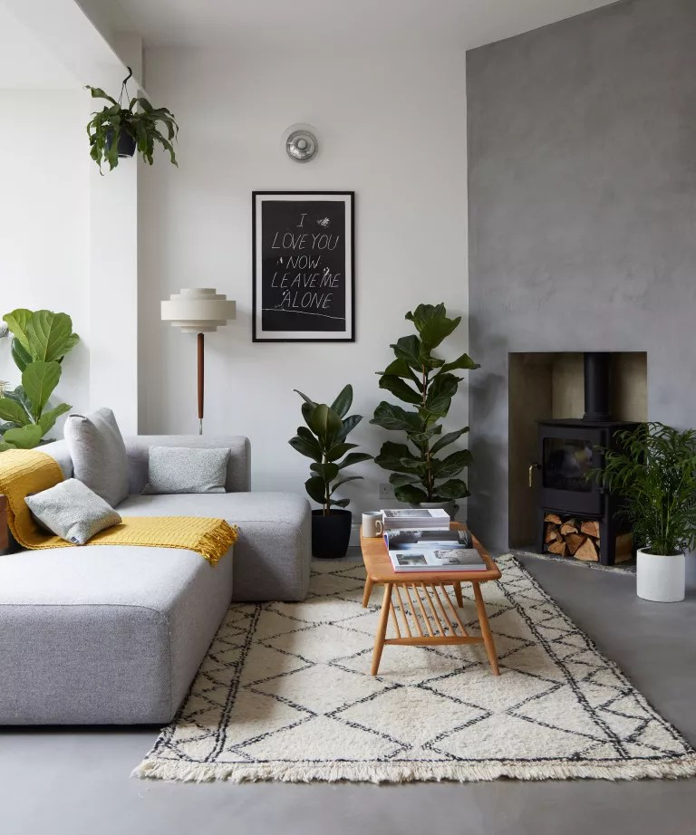 Mid-century modern living room with grey walls and wood furniture