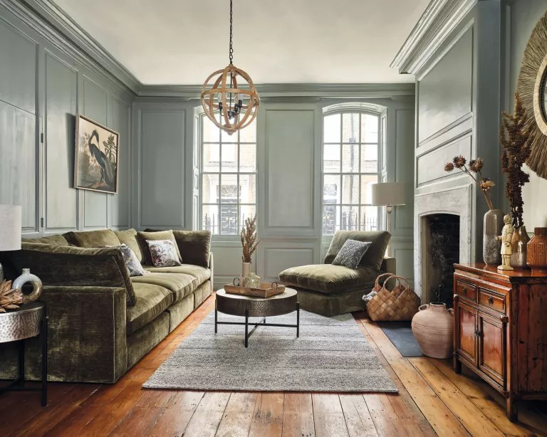 Living room fall decor with leather sofa, wood floor and furniture
