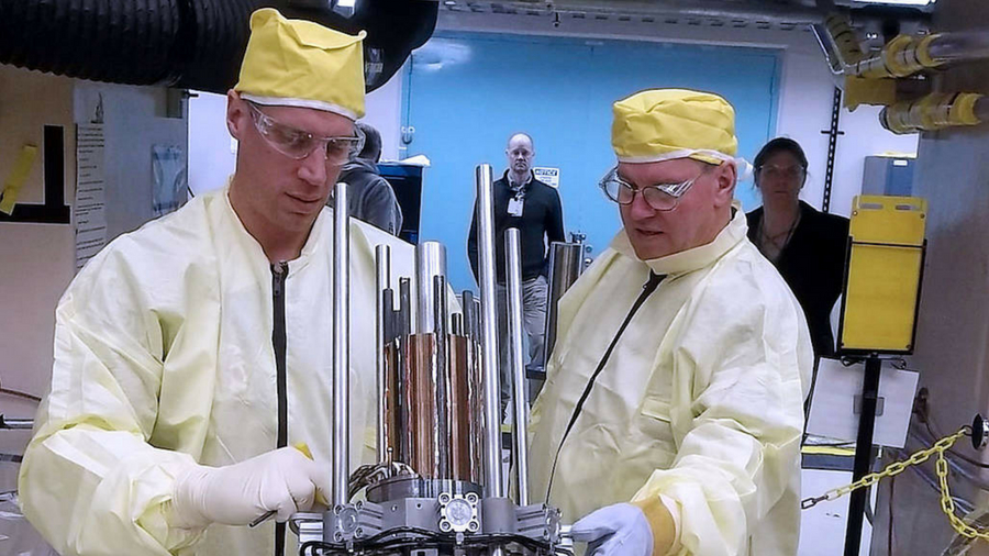 Image of technicians with components for the Kilopower reactor