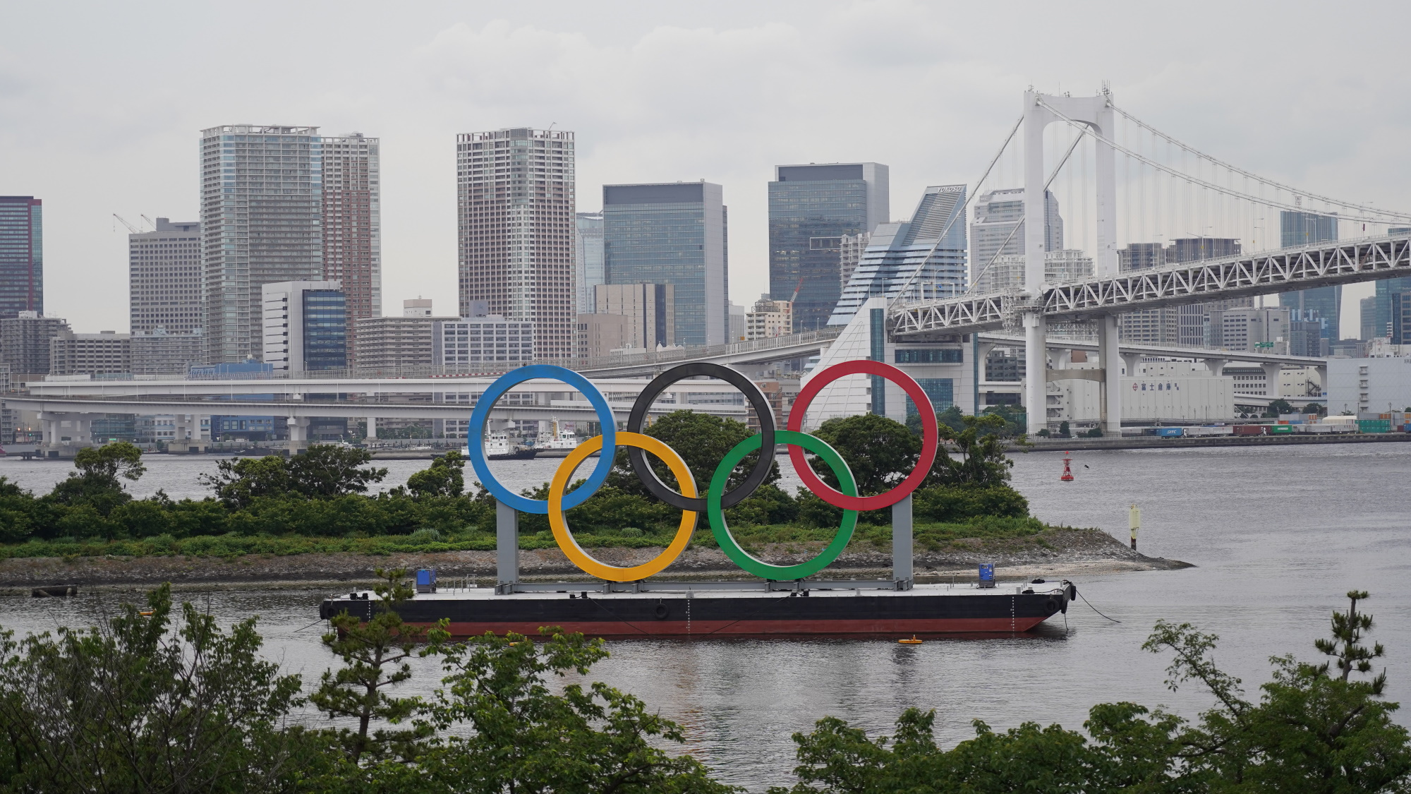 The Olympic Rings are seen displayed by the Odaiba Marine Park