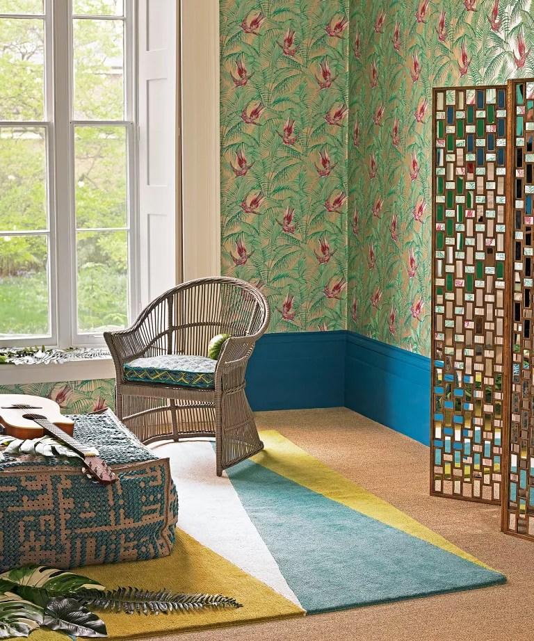 Bohemian bedroom ideas with patterned wall and rattan furniture