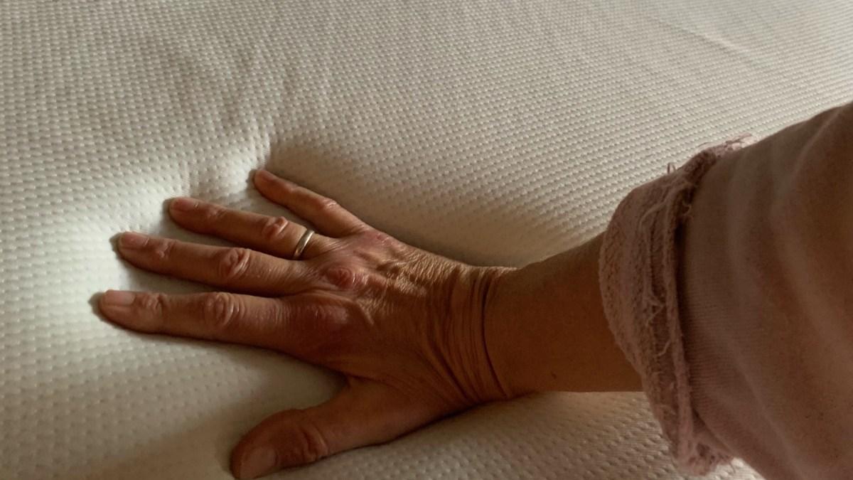 Helix Midnight mattress review: hand pressing into mattress