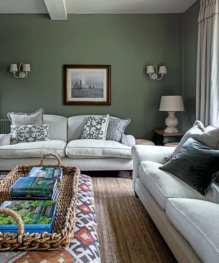 Green living room with white sofa and sisal carpet
