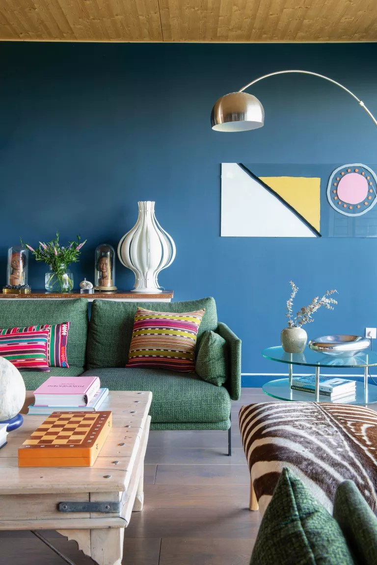 Blue living room with green sofa
