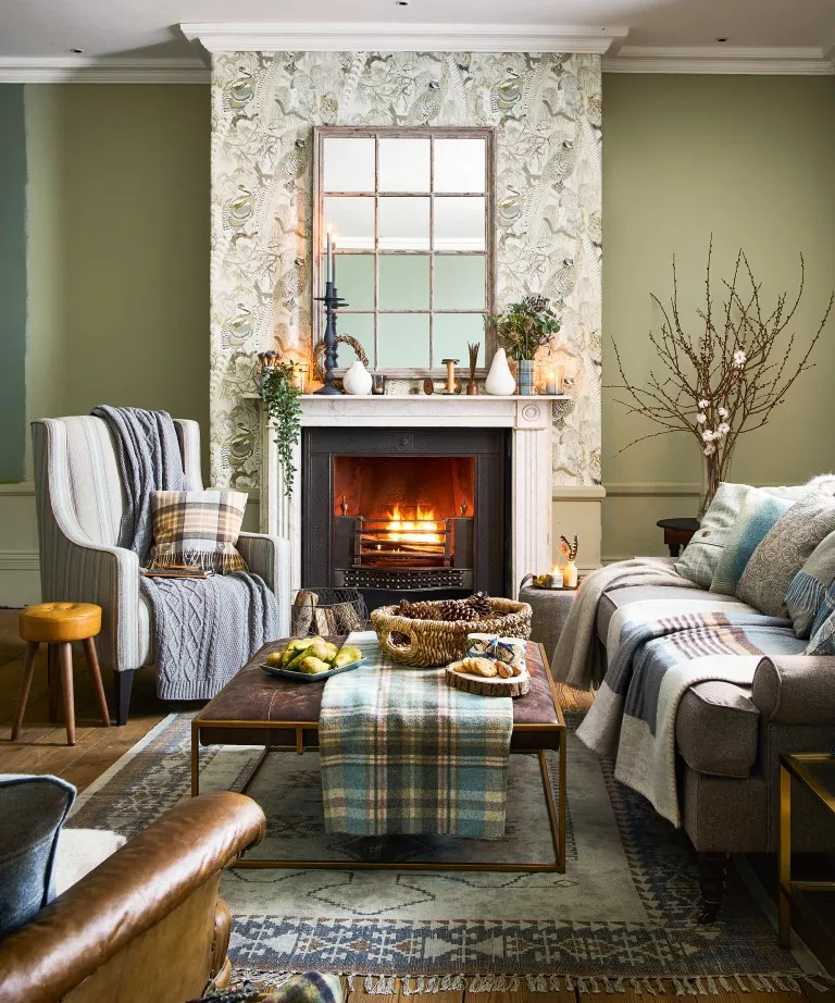 Fall mantel ideas with blue and white vase matching blue and white tartan blankets on grey sofas