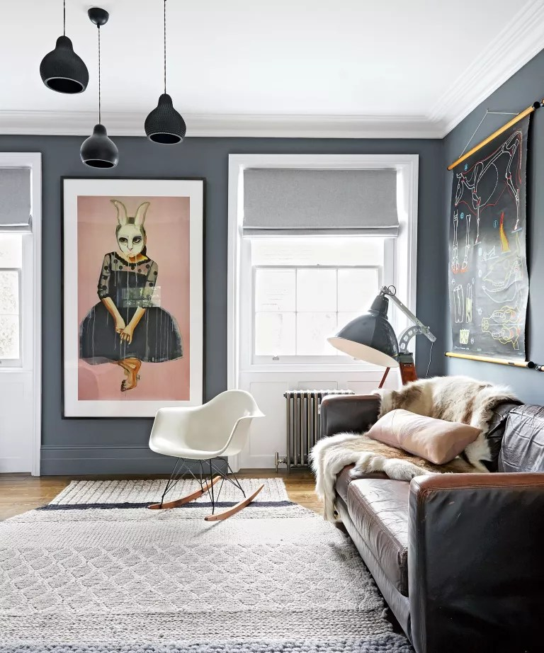 Living room ideas for men with black wall and leather sofa