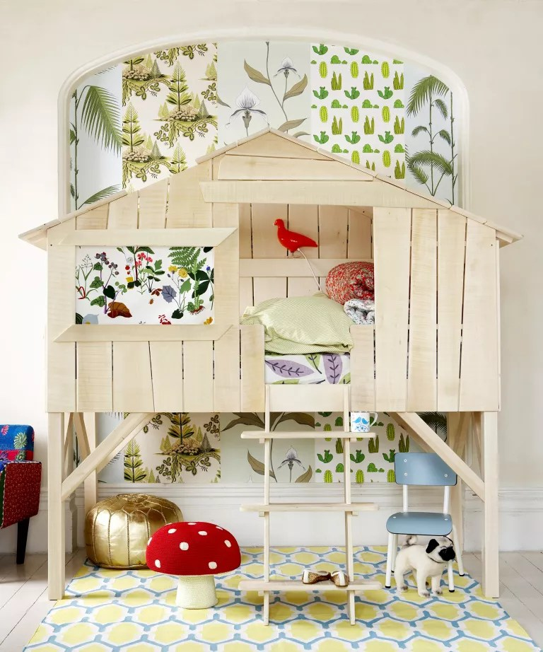 A child's bedroom with a loft bed shaped like a treehouse