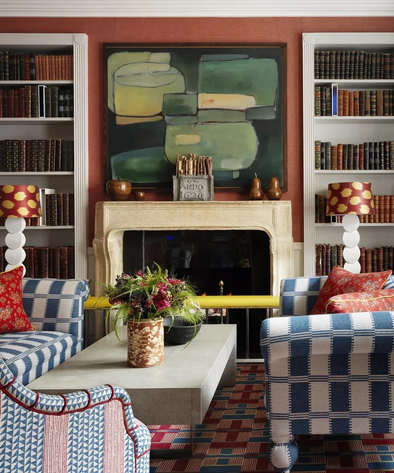 Fall mantel ideas with burnt orange wallpaper, stone mantelpiece, wooden apple and pear ornaments