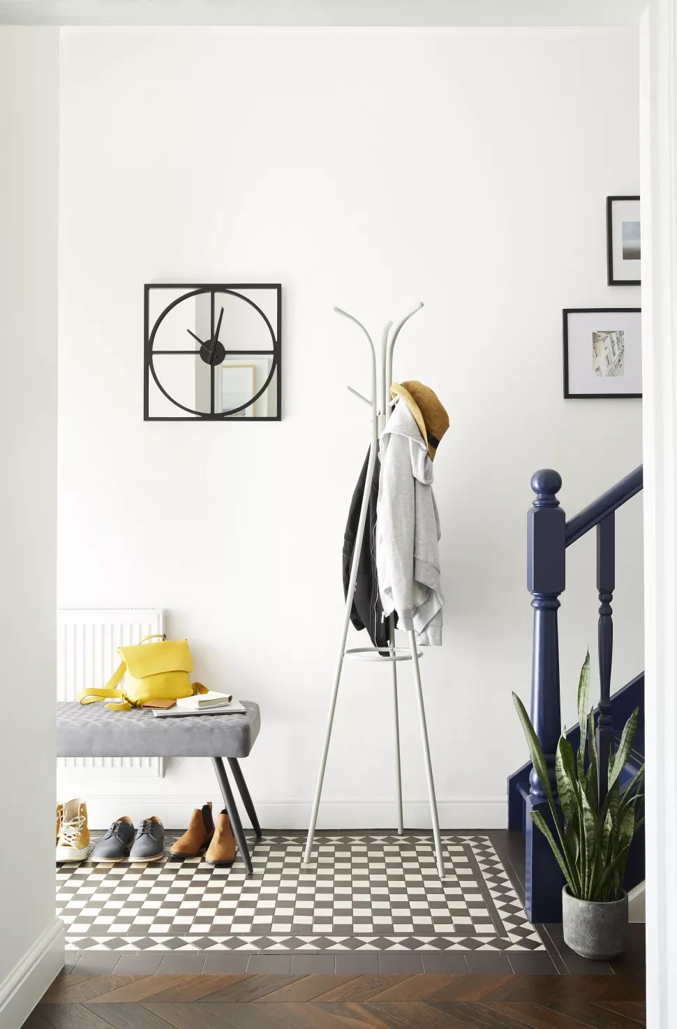 small hallway idea with a freestanding coat rack