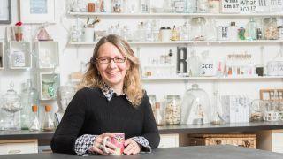 Sarah Hyndman sitting at a desk